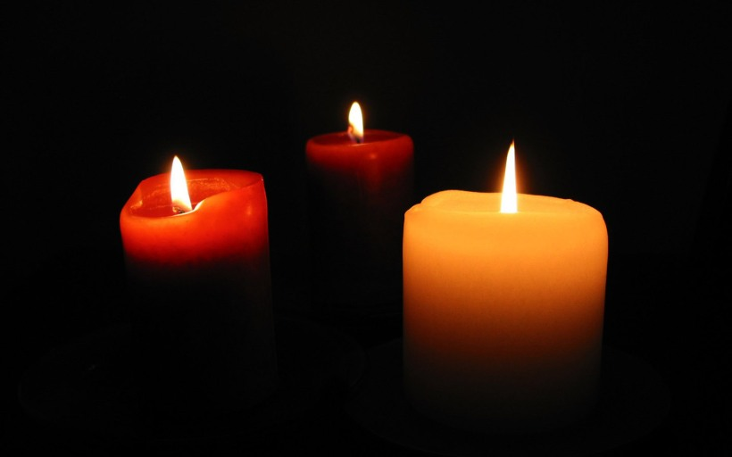 three candles for PTSD anniversary